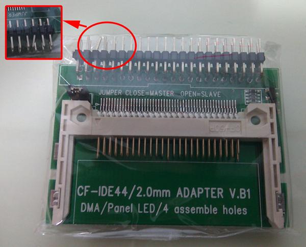 제품의 포장 상태 사진. 정전기 방지 포장만 뜯고 내포장은 뜯지 않은 상태인데, 핀 하나가 휘어 있는 것이 보입니다.